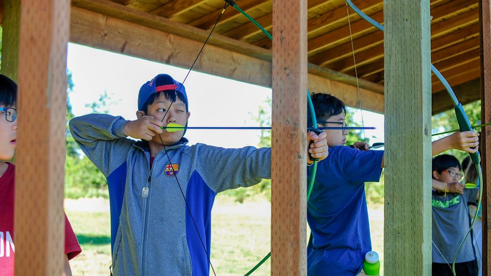 Archery at summer camp at Warm Beach Camp & Conference Center, Stanwood, WA, near Seattle.
